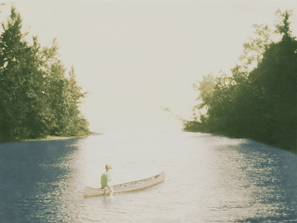 Thomas in the Canoe, from the series, Enter the Great Wide Open. © Aislinn Leggett.