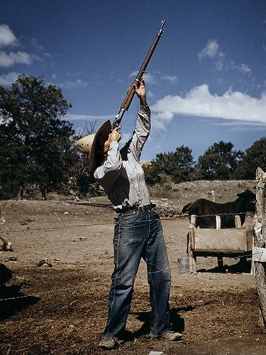 Nell Leathers, homesteader, shooting hawks which have been carrying away her chickens. © Debbie Grossman