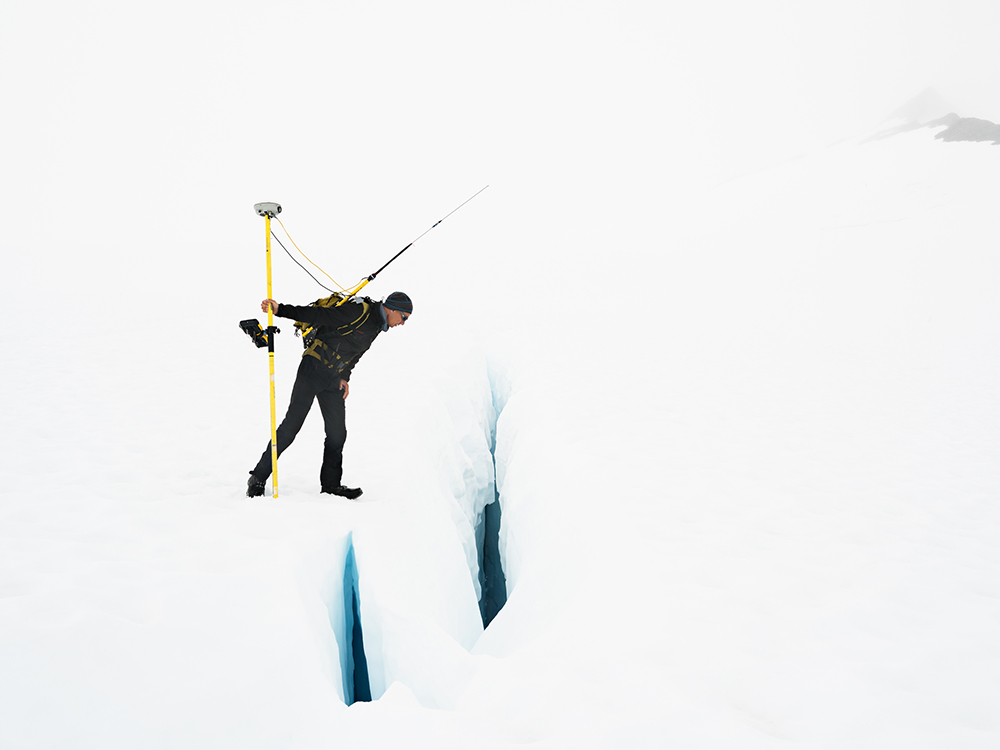 Uwe Measuring the Velocity of a Glacier, Juneau Icefield Research Program, Alaska 2016. © Lucas Foglia and courtesy Fredericks & Freiser Gallery, New York.